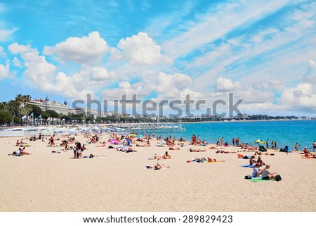 CANNES, FRANCE - JUNE 2, 2015: People on the most popular beach in Cannes, France  - Plage de la Croisette - the famous beach on the Croisette, known for its film festival.