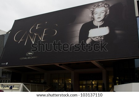 CANNES, FRANCE-MAY 20: A giant poster with an iconic photo of Marilyn Monroe at the 65th Cannes film festival on May 20, 2012 in Cannes, France. This year edition is dedicated to the legendary American actress - stock photo