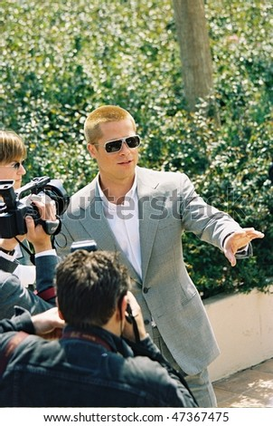 CANNES, FRANCE - MAY 13: Actor Brad Pitt attends the Photocall for 'Troy' ahead of tonight's World Premiere showing, at the 57th Annual Cannes Film Festival on May 13, 2004 in Cannes, France - stock photo