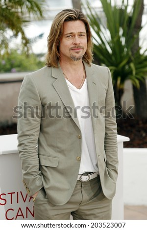 CANNES, FRANCE - MAY 22: Actor Brad Pitt poses during the photo-call of 'Killing them Softly' presented in competition at the 65th Cannes film festival on May 22, 2012 in Cannes.