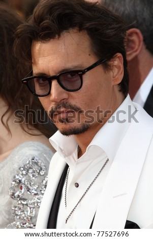CANNES, FRANCE - MAY 14: Actor Johnny Depp attends the 'Pirates of the Caribbean: On Stranger Tides' premiere at the Palais  during the 64th Cannes Film Festival on May 14, 2011 in Cannes, France. - stock photo