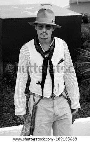 CANNES, FRANCE - MAY 14 : Actor Johnny Depp attends the 'Pirates of the Caribbean' photo-call during the 64th  Cannes Film Festival on May 14, 2011 in Cannes, France. - stock photo