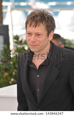 "CANNES, FRANCE - MAY 25, 2013: Actor Mathieu Amalric at the photocall for his movie ""Venus in Fur"" in competition at the 66th Festival de Cannes."