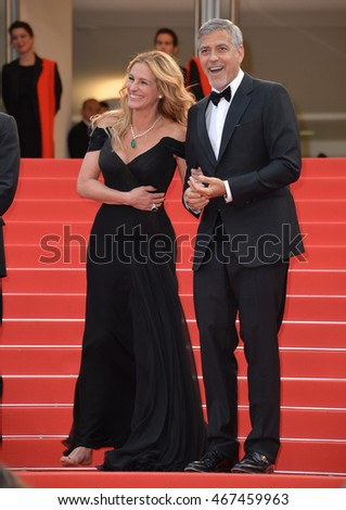 "CANNES, FRANCE - MAY 12, 2016: Actors George Clooney & Julia Roberts at the gala premiere for ""Money Monster"" at the 69th Festival de Cannes."