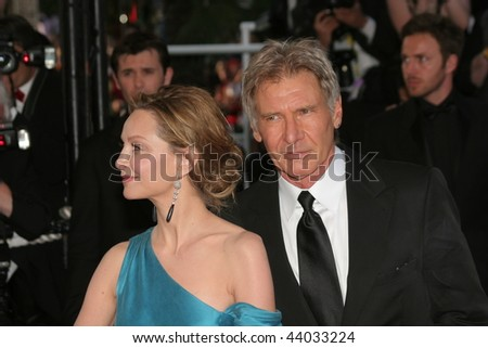 CANNES, FRANCE - MAY 18: Actors Harrison Ford and Calista Flockhart attend the Indiana Jones premiere at the Palais des Festivals during the 61st Cannes  Film Festival on May 18, 2008  France. - stock photo