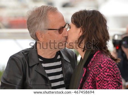 "CANNES, FRANCE - MAY 13, 2016: Actors Juliette Binoche & Fabrice Luchini at the photocall for ""Slack Bay"" (""Ma Loute"") at the 69th Festival de Cannes."