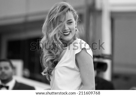 CANNES, FRANCE - MAY 20, 2014: Actress Amber Heard walks down the red carpet during the 67th Annual Cannes Film Festival on May 20, 2014 in Cannes, France. - stock photo