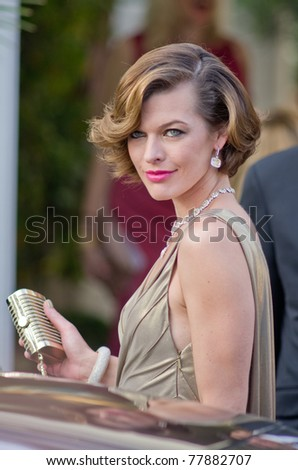 CANNES, FRANCE - MAY 19: actress and topmodel milla jovovich leaves hotel martinez during the 64th Annual Cannes Film Festival on May 19, 2011 in Cannes, France. - stock photo