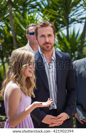 Cannes, France - 15 MAY 2016 - Actress Angourie Rice and Actor Ryan Gosling attend 'The Nice Guys' photocall during the 69th annual Cannes Film Festival - stock photo