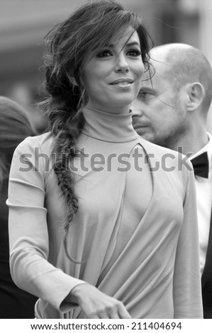 CANNES, FRANCE - MAY 19, 2014: Actress Eva Longoria walks down the red carpet during the 67th Annual Cannes Film Festival on May 19, 2014 in Cannes, France.