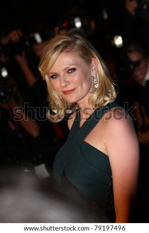 CANNES, FRANCE - MAY 18: Actress Kirsten Dunst attends the 'Melancholia' premiere during the 64th Annual Cannes Film Festival at Palais des Festivals on May 18, 2011 in Cannes, France. - stock photo