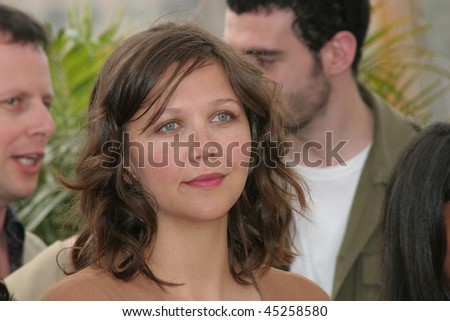 CANNES, FRANCE - MAY 18: Actress Maggie Gyllenhaal attends a photocall promoting the film 'Paris Je T'aime' during the 59th International Cannes Film Festival May 18, 2006 in Cannes, France - stock photo