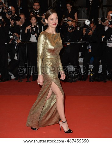 "CANNES, FRANCE - MAY 15, 2016: Actress Marion Cotillard at the gala premiere of ""From the Land of the Moon"" (""Mal de Pierres"") at the 69th Festival de Cannes."