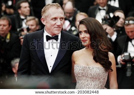 CANNES, FRANCE - MAY 11: Actress Salma Hayek and her husband Francois-Henri Pinault attend the Opening Ceremony during the 64th Cannes Film Festival on May 11, 2011 in Cannes, France.  - stock photo