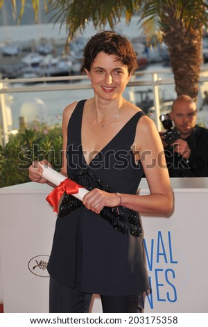 "CANNES, FRANCE - MAY 24, 2014: Alice Rohrwacher, winner of the Grand Prize for ""The Wonders"", at the awards photocall at the 67th Festival de Cannes."