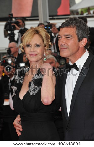 "CANNES, FRANCE - MAY 11, 2011: Antonio Banderas & Melanie Griffith at the gala premiere for ""Midnight in Paris"" the opening film at the 64th Festival de Cannes. May 11, 2011  Cannes, France"