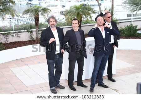CANNES, FRANCE - MAY 22:  Benoit Poelvoorde and Actor Albert Dupontel pose at the 'Le Grand Soir' photocall during the 65th Cannes Film Festival at Palais  on May 22, 2012 in Cannes, France.