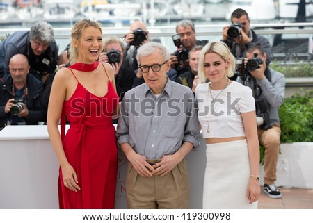 CANNES, FRANCE - MAY 11: Blake Lively , Woody Allen and Kristen Stewart attend the 'Cafe Society' photocall, 69th annual Cannes Film Festival at Palais des Festivals on May 11, 2016 in Cannes, France. - stock photo