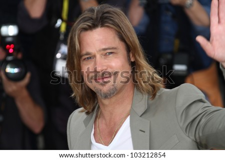 CANNES, FRANCE - MAY 22: Brad Pitt poses at the 'Killing Them Softly' photocall during the 65th Annual Cannes Film Festival at Palais des Festivals on May 22, 2012 in Cannes, France. - stock photo