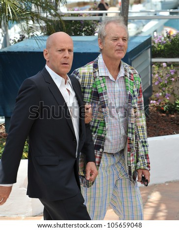 "CANNES, FRANCE - MAY 16, 2012: Bruce Willis & Bill Murray at the photocall for their new movie ""Moonrise Kingdom"" at the 65th Festival de Cannes. May 16, 2012  Cannes, France"