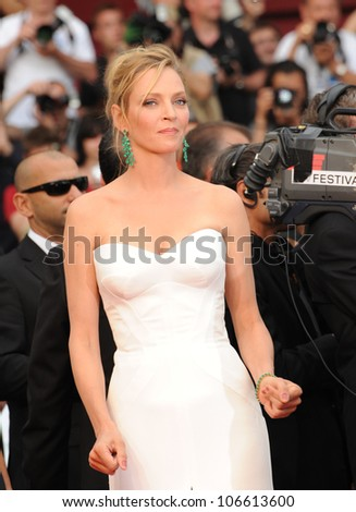 """CANNES, FRANCE - MAY 11, 2011: Cannes Jury member Uma Thurman at the gala premiere for """"Midnight in Paris"""" the opening film at the 64th Festival de Cannes. May 11, 2011  Cannes, France - stock photo"""
