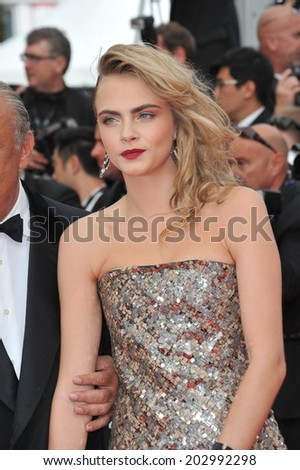 "CANNES, FRANCE - MAY 21, 2014: Cara Delevingne at the gala premiere of ""The Search"" at the 67th Festival de Cannes.  - stock photo"