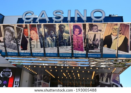 CANNES,FRANCE- MAY 14: Casino facade shown in may 14, 2014 in Cannes, France. Posters of actors retrospective of the International Film Festival on the casino adjacent of the Festival Palace in Cannes - stock photo
