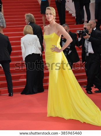 "CANNES, FRANCE - MAY 14, 2015: Charlize Theron at the gala premiere of her movie ""Mad Max: Fury Road"" at the 68th Festival de Cannes."