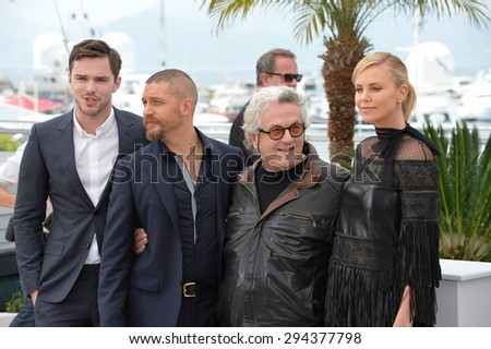 "CANNES, FRANCE - MAY 14, 2015: Charlize Theron, Tom Hardy, Nicholas Hoult & director George Miller at the photocall for their movie ""Mad Max: Fury Road"" at the 68th Festival de Cannes."