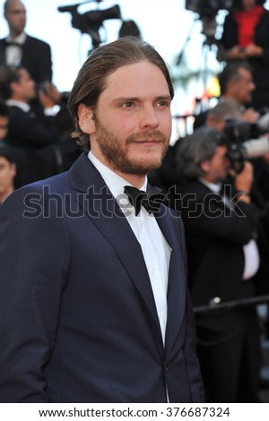 "CANNES, FRANCE - MAY 23, 2014: Daniel Bruehl at gala premiere of ""Clouds of Sils Maria"" at the 67th Festival de Cannes."