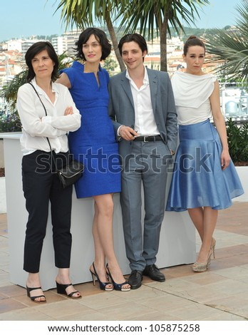 "CANNES, FRANCE - MAY 25, 2012: Director Cathering Corsini (left), actors Clotilde Hesme, Raphael Personnaz & Arta Dobroshi at the photocall for ""Three Worlds"" in Cannes. May 25, 2012  Cannes, France"