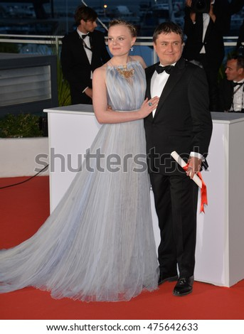 CANNES, FRANCE - MAY 22, 2016: Director Cristian Mungiu, joint winner of Best Director for 'Graduation', & actress Maria Dragus at the winners' photocall at the 69th Festival de Cannes.