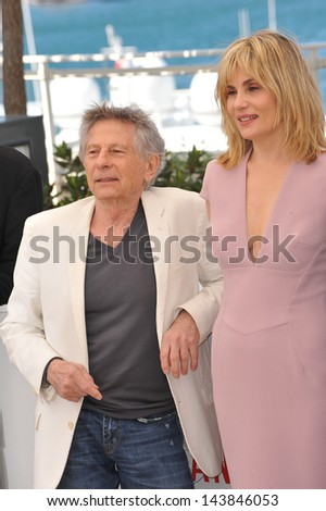 "CANNES, FRANCE - MAY 25, 2013: Director Roman Polanski & wife actress Emmanuelle Seigner at the photocall for their movie ""Venus in Fur"" in competition at the 66th Festival de Cannes."