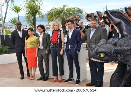 "CANNES, FRANCE - MAY 16, 2014: Djimon Hounsou, Cate Blanchett, America Ferrera, Jay Baruchel, Kit Harington & director Dean Deblois at the photocall for their movie ""How to Train Your Dragon 2""  - stock photo"