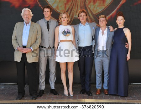 "CANNES, FRANCE - MAY 17, 2014: Donald Sutherland, Liam Hemsworth, Jennifer Lawrence, Sam Claflin, Josh Hutcherson & Julianne Moore at photo call for ""The Hunger Games: Mockingjay - Part 1"" at Cannes"