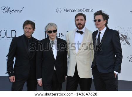 CANNES, FRANCE - MAY 23, 2013: Duran Duran - Nick Rhodes, Simon Le Bon, John Taylor & Roger Taylor at amfAR's 20th Cinema Against AIDS Gala at the Hotel du Cap d'Antibes, France  - stock photo