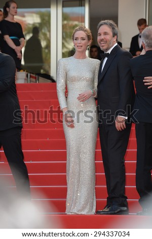 "CANNES, FRANCE - MAY 19, 2015: Emily Blunt & director Denis Villeneuve at the gala premiere for their movie ""Sicario"" at the 68th Festival de Cannes."