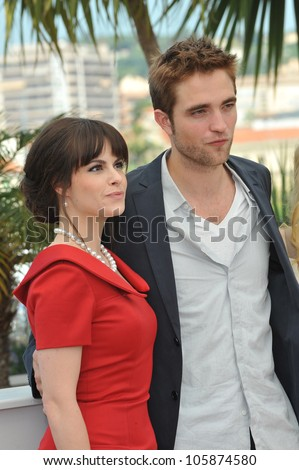 "CANNES, FRANCE - MAY 25, 2012: Emily Hampshire & Robert Pattinson at the photocall for ""Cosmopolis"" in Cannes. May 25, 2012  Cannes, France"