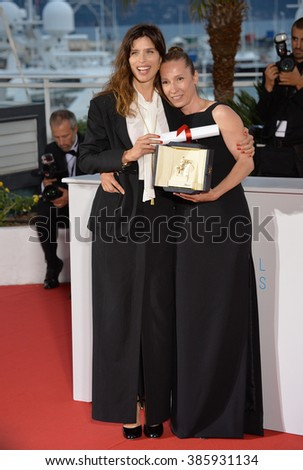 CANNES, FRANCE - MAY 24, 2015: Emmanuelle Bercot - joint winner of the Best Actress Award - & director Maiwenn (left) at the winners' photocall at the 68th Festival de Cannes. - stock photo