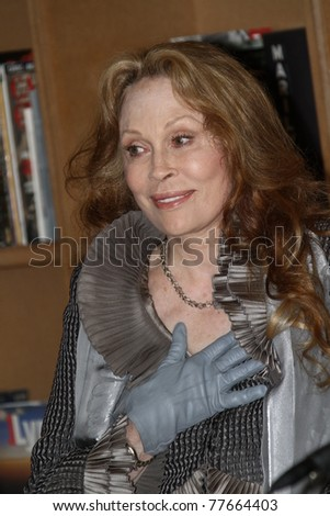 CANNES, FRANCE - MAY 15: Faye Dunaway receives the Order Of Arts And Letters Medal at Cafe des Palmes during the 64th Cannes Film Festival on May 15, 2011 in Cannes, France - stock photo