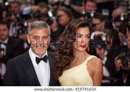 Cannes, France - 12 MAY 2016 - George Clooney and Amal Clooney attend the screening of 'Money Monster' at the annual 69th Cannes Film Festival - stock photo