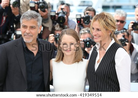 CANNES, FRANCE - MAY 12: George Clooney, Jodie Foster and Julia Roberts attend the 'Money Monster' photocall,  69th annual Cannes Film Festival at the Palais des Festivals on May 12, 2016 in Cannes - stock photo