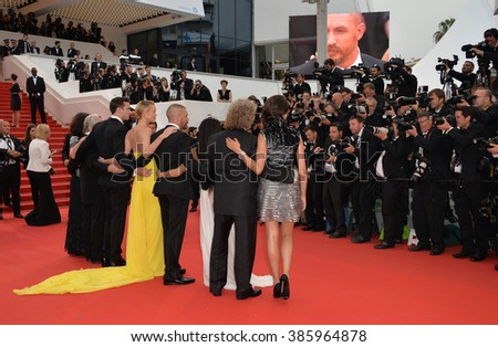 "CANNES, FRANCE - MAY 14, 2015: George Miller & Nicholas Hoult,Charlize Theron, Tom Hardy, Zoe Kravitz and Doug Mitchell  at the gala premiere of ""Mad Max: Fury Road"" at the 68th Festival de Cannes."