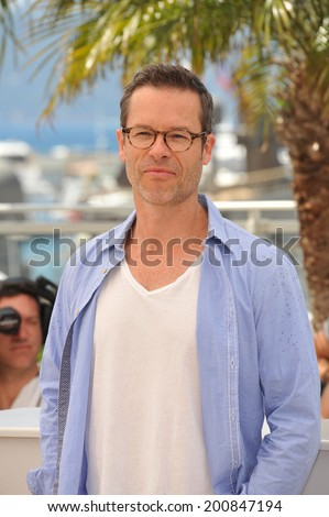 "CANNES, FRANCE - MAY 18, 2014: Guy Pearce at the photocall for his movie ""The Rover"" at the 67th Festival de Cannes."