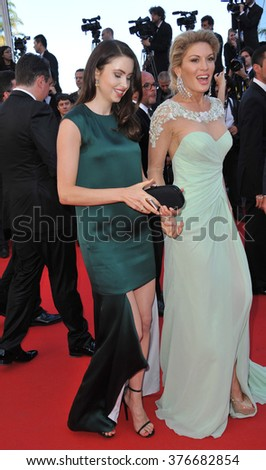 CANNES, FRANCE - MAY 24, 2014: Hofit Golan & Emma Miller (in dark green) at the gala awards ceremony at the 67th Festival de Cannes. - stock photo