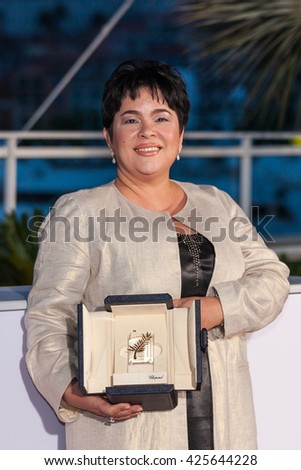 Cannes, France - 22 MAY 2016 - Jaclyn Jose poses after being awarded the Best Actress prize for the movie Ã??MaÃ??RosaÃ?? during the Palme D'Or Winner Photocall during 69th annual Cannes Film Festival - stock photo