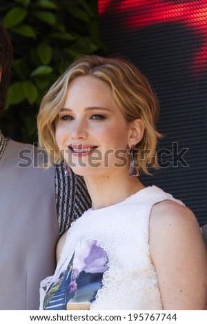 CANNES, FRANCE - MAY 17: Jennifer Lawrence attends 'The Hunger Games: Mockingjay Part 1' Photocall - at the 67th Annual Cannes Film Festival on May 17, 2014 in Cannes, France - stock photo