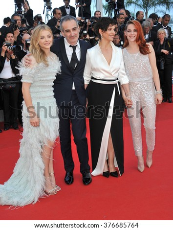 """CANNES, FRANCE - MAY 23, 2014: Juliette Binoche, Kristen Stewart, Chloe Grace Moretz & director Olivier Assayas at gala premiere of their movie """"Clouds of Sils Maria"""" at the 67th Festival de Cannes. - stock photo"""