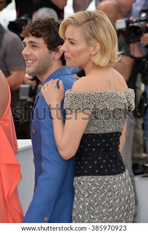 CANNES, FRANCE - MAY 13, 2015: Jury members Sienna Miller & Xavier Dolan at photocall for the Cannes Jury at the 68th Festival de Cannes.