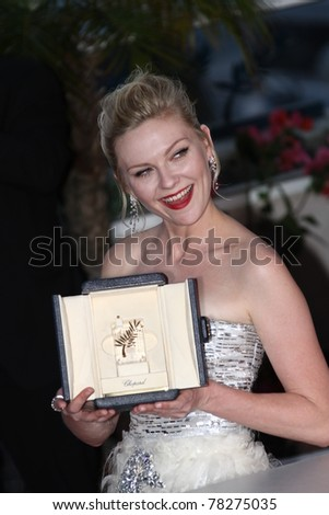 CANNES, FRANCE - MAY 22: Kirsten Dunst attends the Palme D'Or Winners Photocall at the 64th Annual Cannes Film Festival at Palais des Festivals on May 22, 2011 in Cannes, France - stock photo